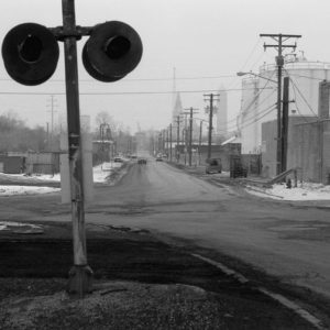 The intersection of Quigley Road and West Third Street beneath Interstate 490, a place where the the gritty, less glamorous side of Cleveland's industrial activity moves near, through or over.