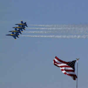 U.S. Navy's Blue Angels fly-by Old Glory.