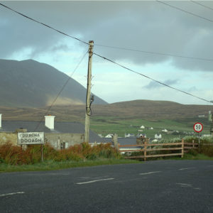 Roadside sign for the village of Dooagh on Achill Island, Co. Mayo, with Slievemore mountain in the background.