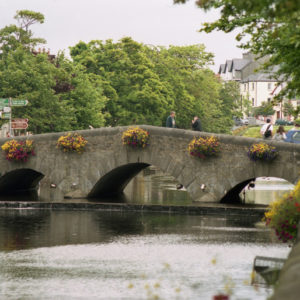 The River Carrowbeg is framed by the Mall in Westport, Co. Mayo, looking northwest toward the Bridge Street bridge.
